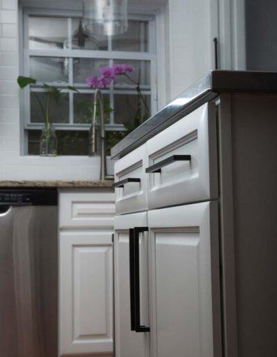 White cabinets with black handles