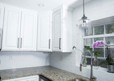 Refinished MDF cabinets painted white